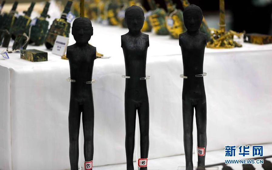被追回的漢代黑陶俑。 圖/摘自新華網
