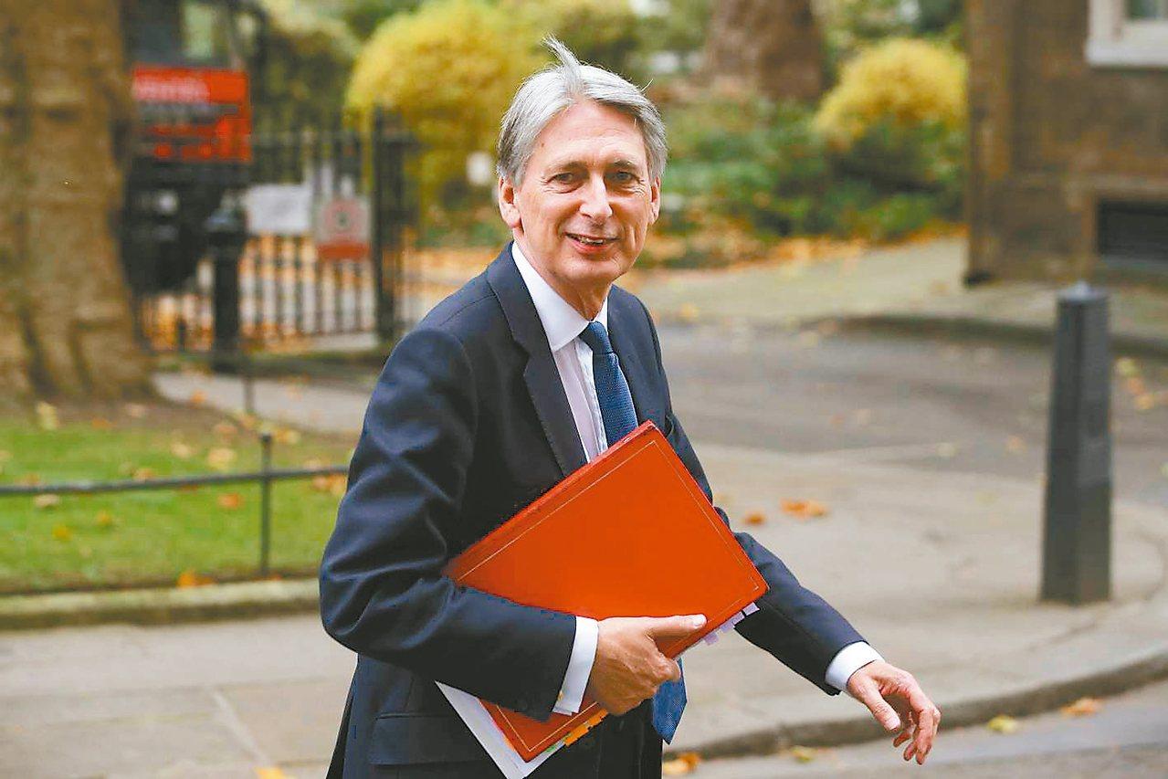 英國財政大臣哈蒙德。 法新社