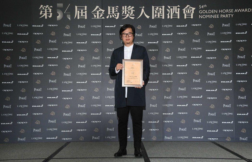 「老獸」也獲得今年金馬獎國際影評人費比西獎。導演周子陽代表領獎。圖/金馬執委會提...