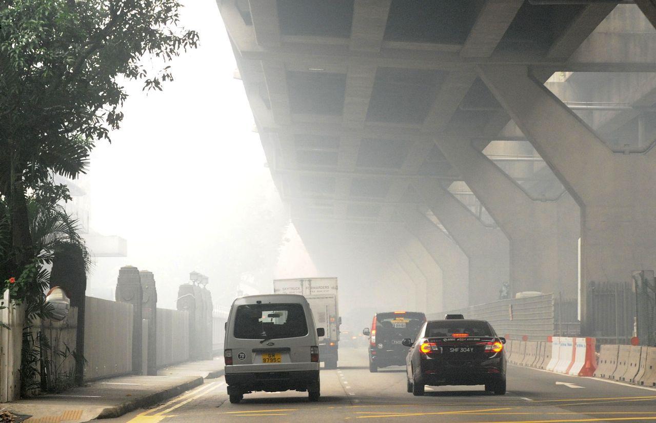 新加坡政府打车花招百出,为的是更有效的利用土地资源。图/美联社