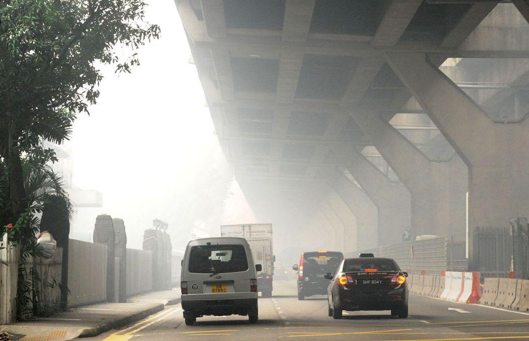 新加坡政府打車花招百出,為的是更有效的利用土地資源。 圖/美聯社