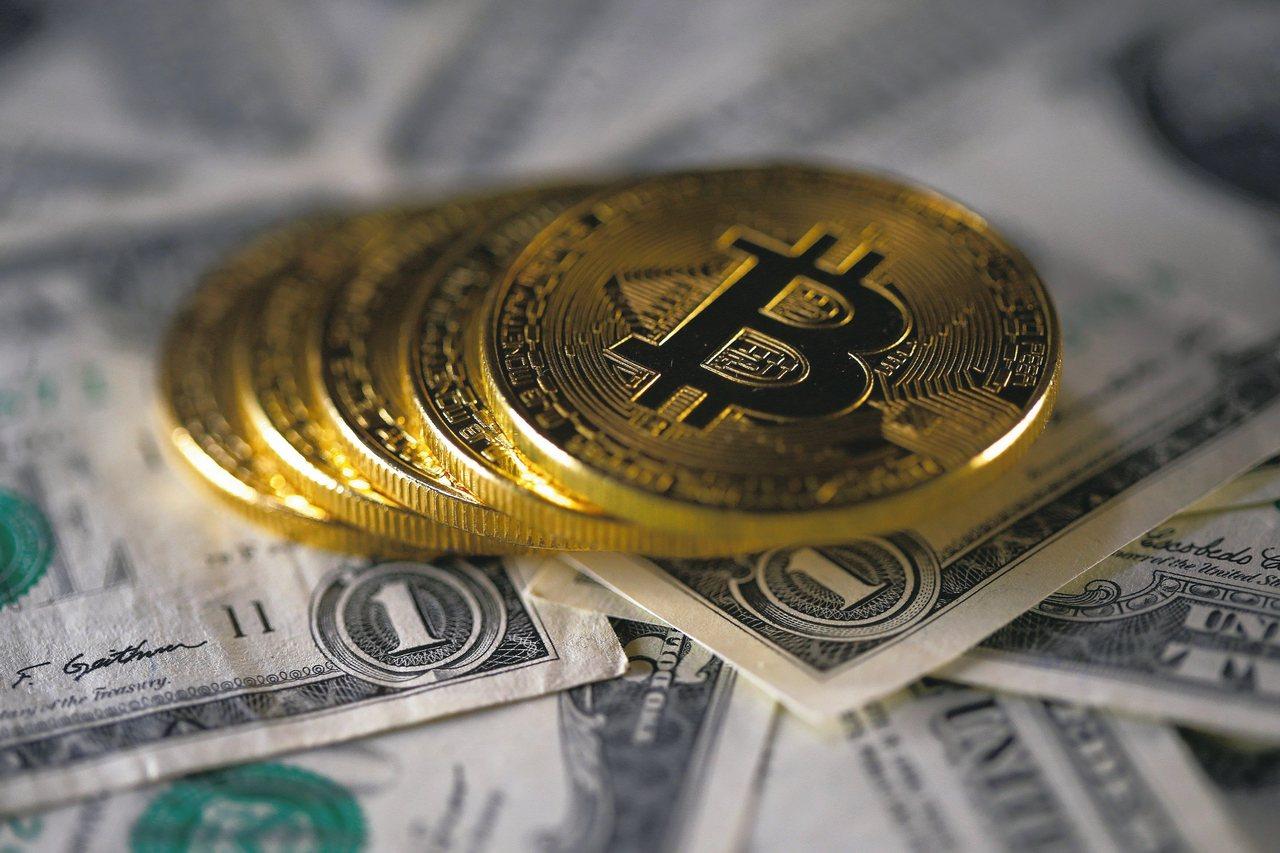 比特幣有望上攻一萬美元,帶動相關概念股。 路透