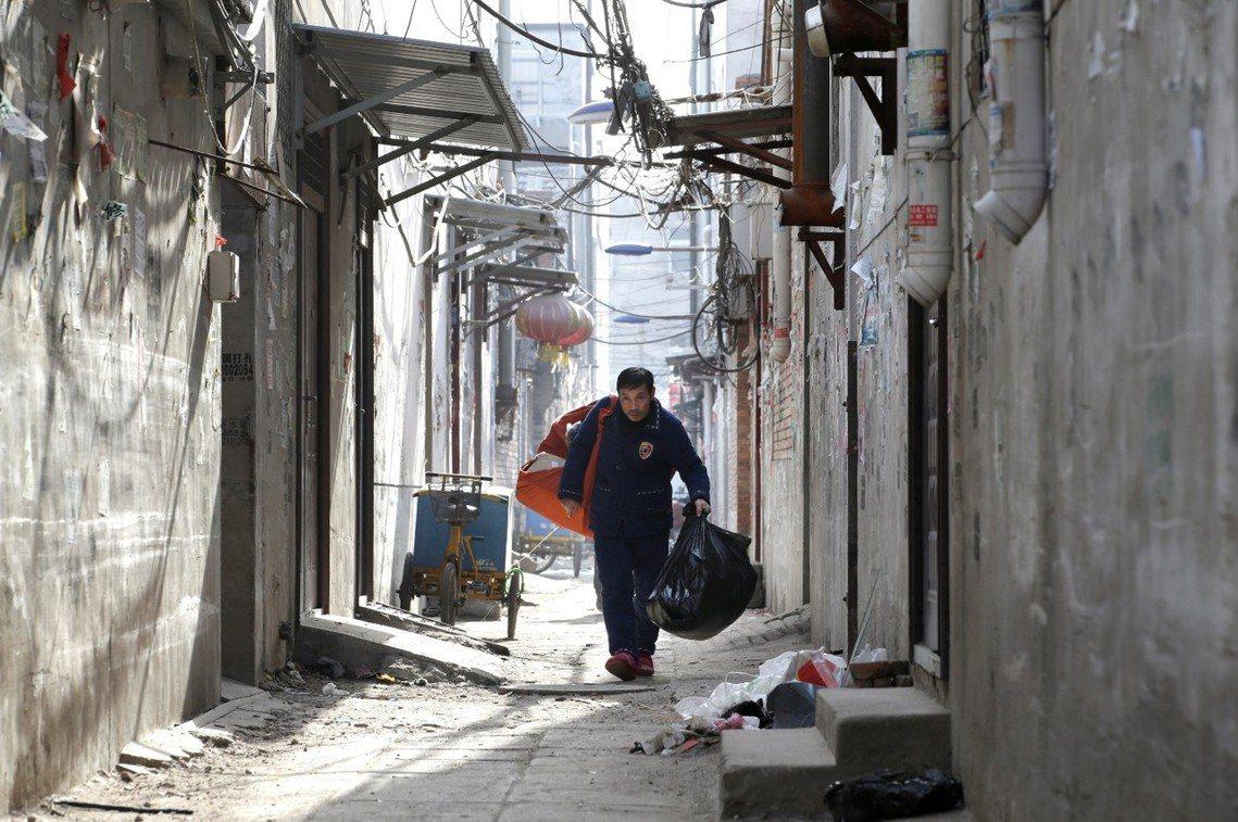 北京市面臨大規模的城市大清退,「低端人口」該何去何從? 圖/路透社