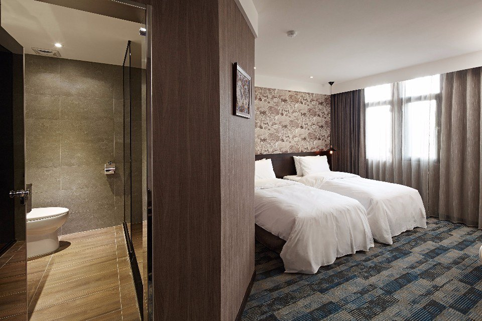 房間以港口命名,還有海港地圖或相片營造海洋氣息。(圖片提供/康瀚行旅)