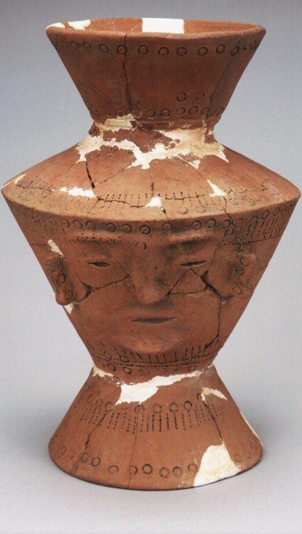 修復前的人面陶罐。圖/十三行博物館提供