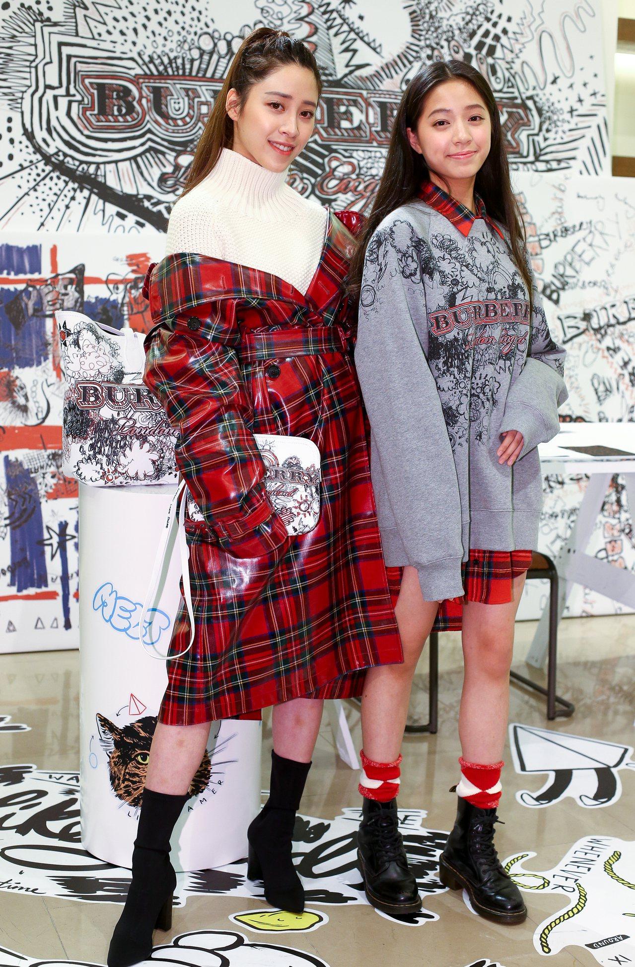 歐陽妮妮身穿紅色蘇格蘭格紋羊毛風衣90,000元、米白色喀什米爾高領針織毛衣33...