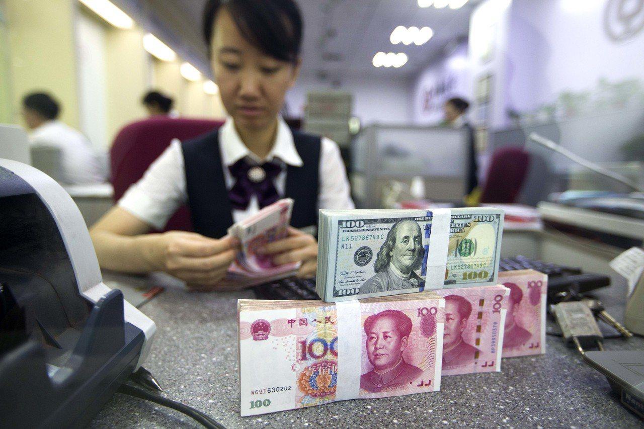 大陸今年10月的持債規模為1.1892兆美元,比9月增持84億美元。中國大陸依然...
