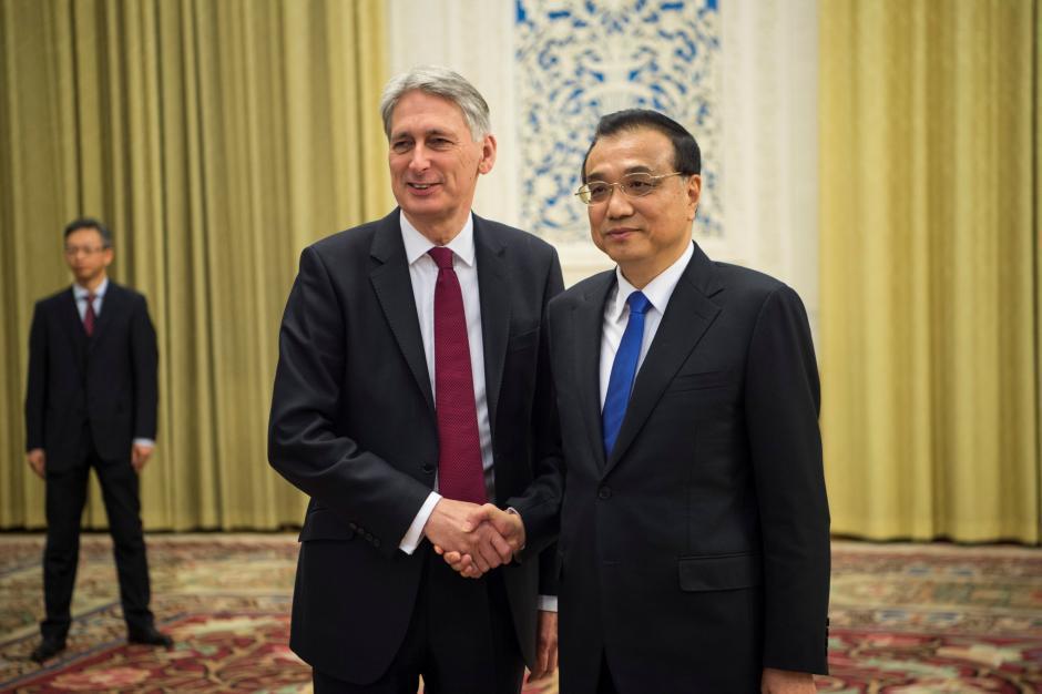 韓蒙德與中國總理李克強16日在北京人民大會堂見面。路透