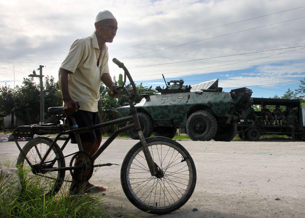 菲律賓社會未來的走向,著實讓人難以看清。 圖/法新社
