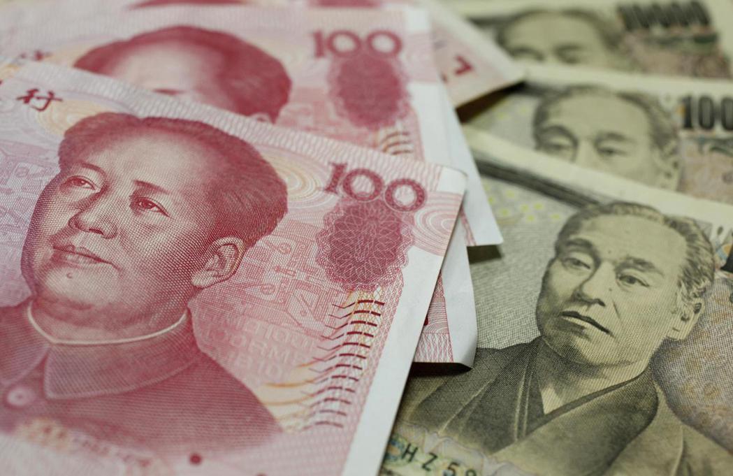 日本與中國將建立金融審查資訊交換機制,幫助日企在中國發行人民幣計價債券。(路透)