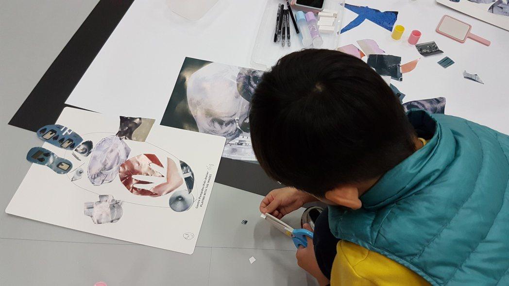 學童利用現有素材,在白紙上發揮想像力,拼貼出自己的五官。記者吳佩旻/攝影