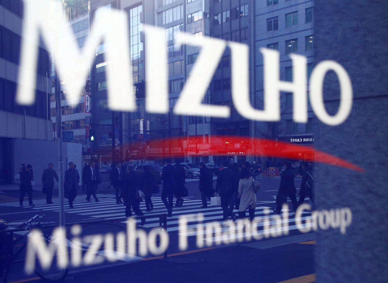 日本瑞穗金融集團明年3月測試發行數位貨幣「J Coin」。(路透)