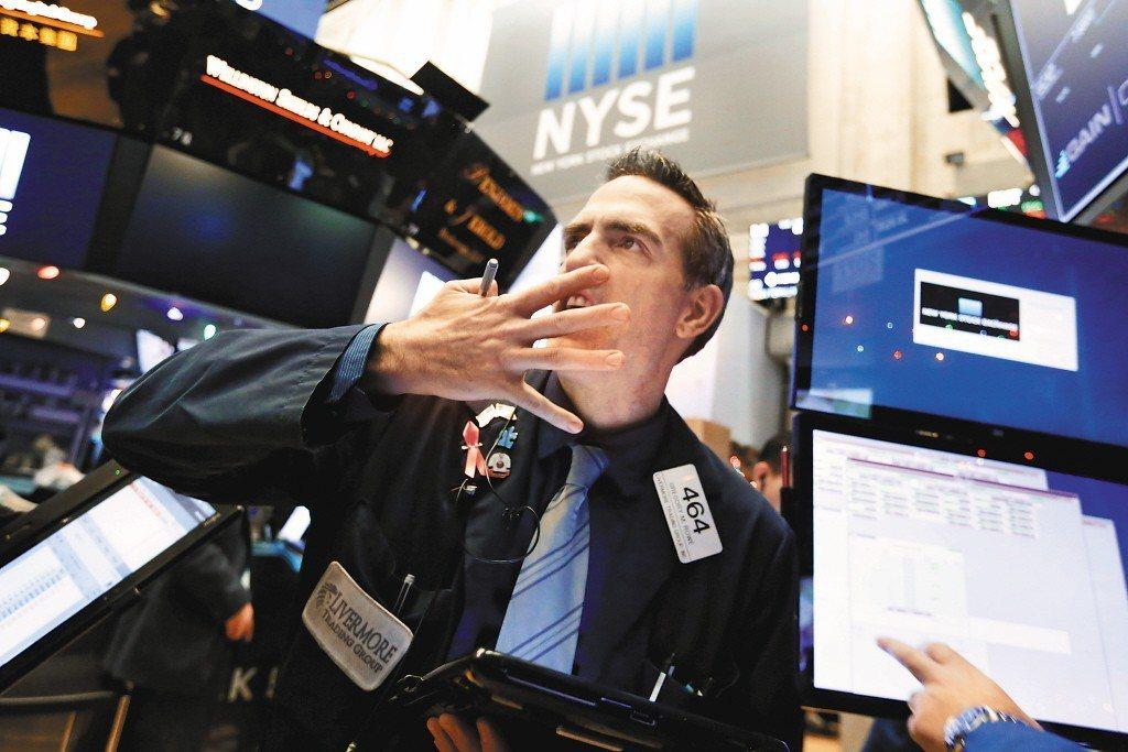 美國稅改牽動全球股市表現。 美聯社
