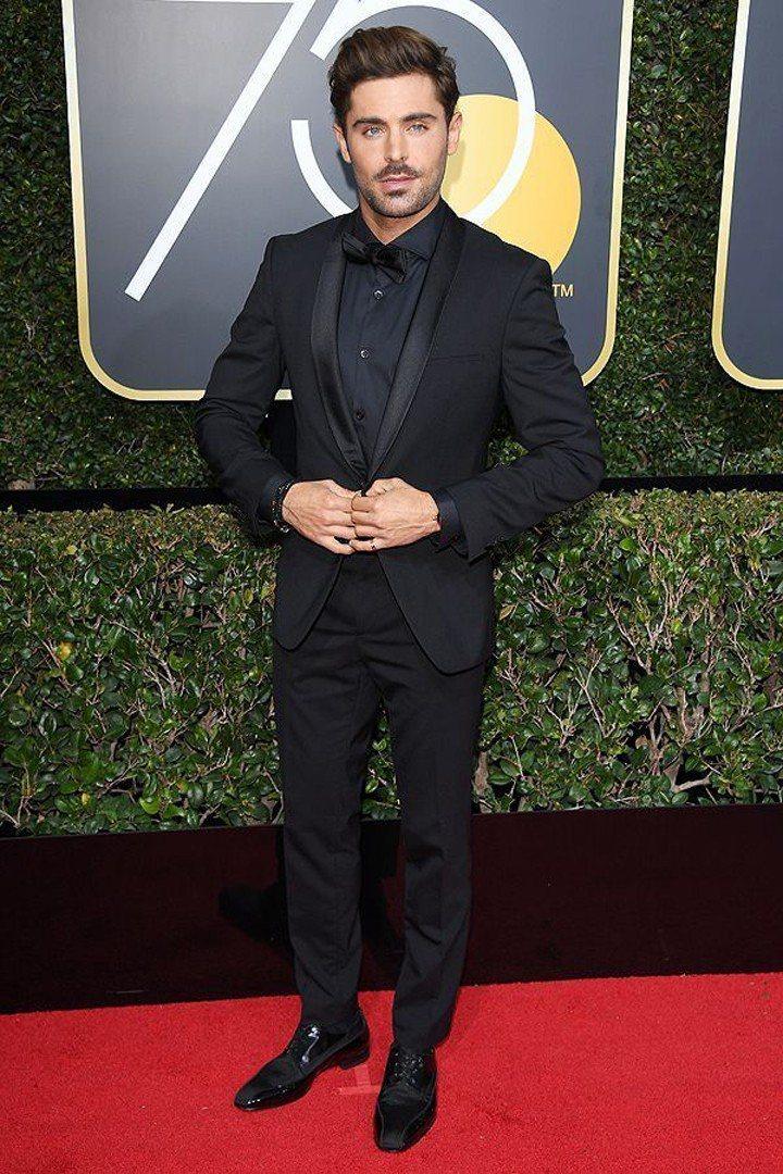 柴克艾佛隆不只是黑西裝連同內搭的襯衫都是黑色,依舊俐落有型。圖/摘自People...
