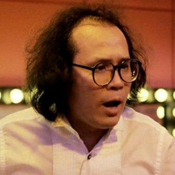 岑建勳在「大小不良」演苦命的魔術師。圖/摘自HKMDB