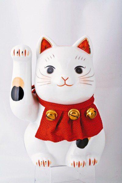 童顏白淨的瓷器招財貓,顯得可愛又無邪。