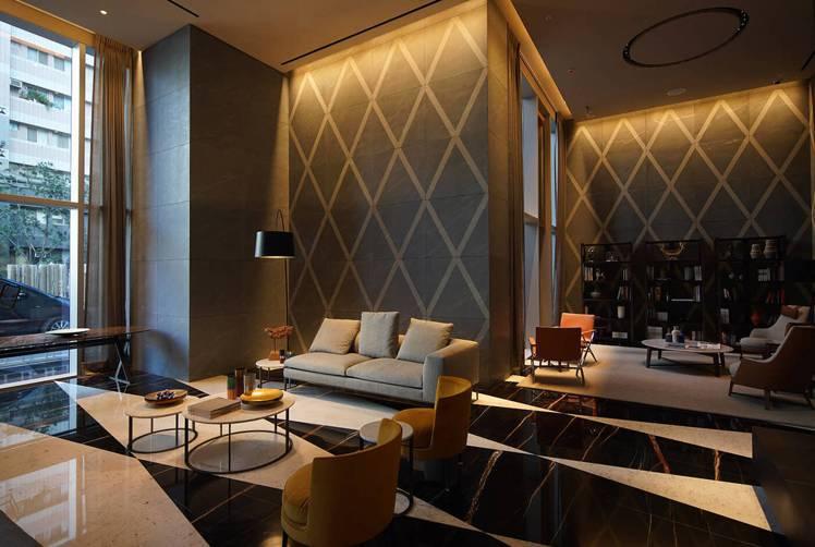 設計師以家具區隔開放空間的功能區。圖/大陸建設提供