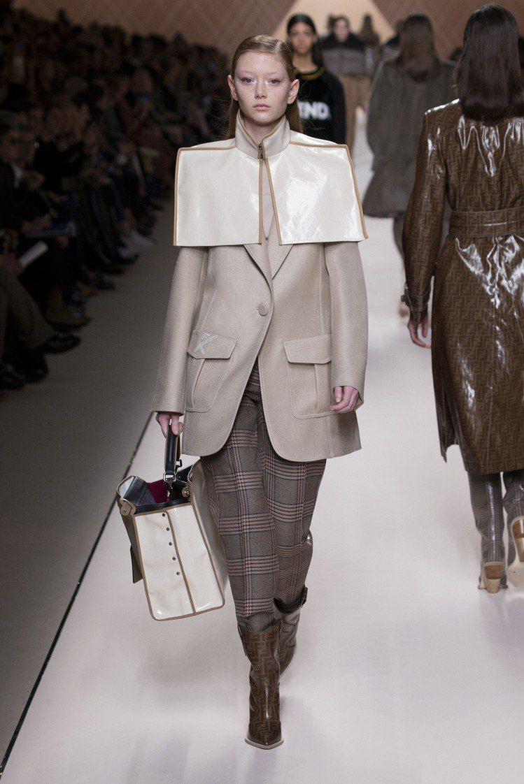 方形肩線、披肩式露肩繫帶大衣,都是FENDI本季亮眼單品。圖/FENDI提供