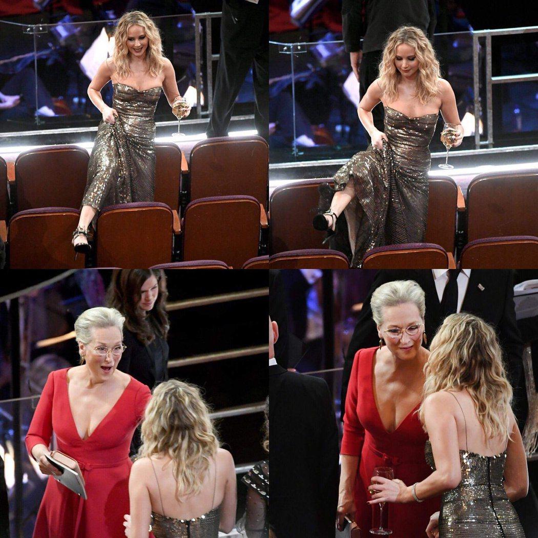 女星珍妮佛勞倫斯利用奧斯卡廣告空檔,穿長禮服跨越椅子和女星梅莉史翠普聊天。 Hu...