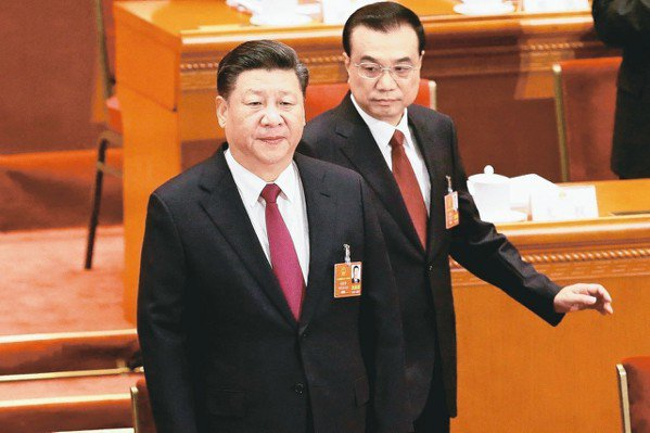 習近平(左)。