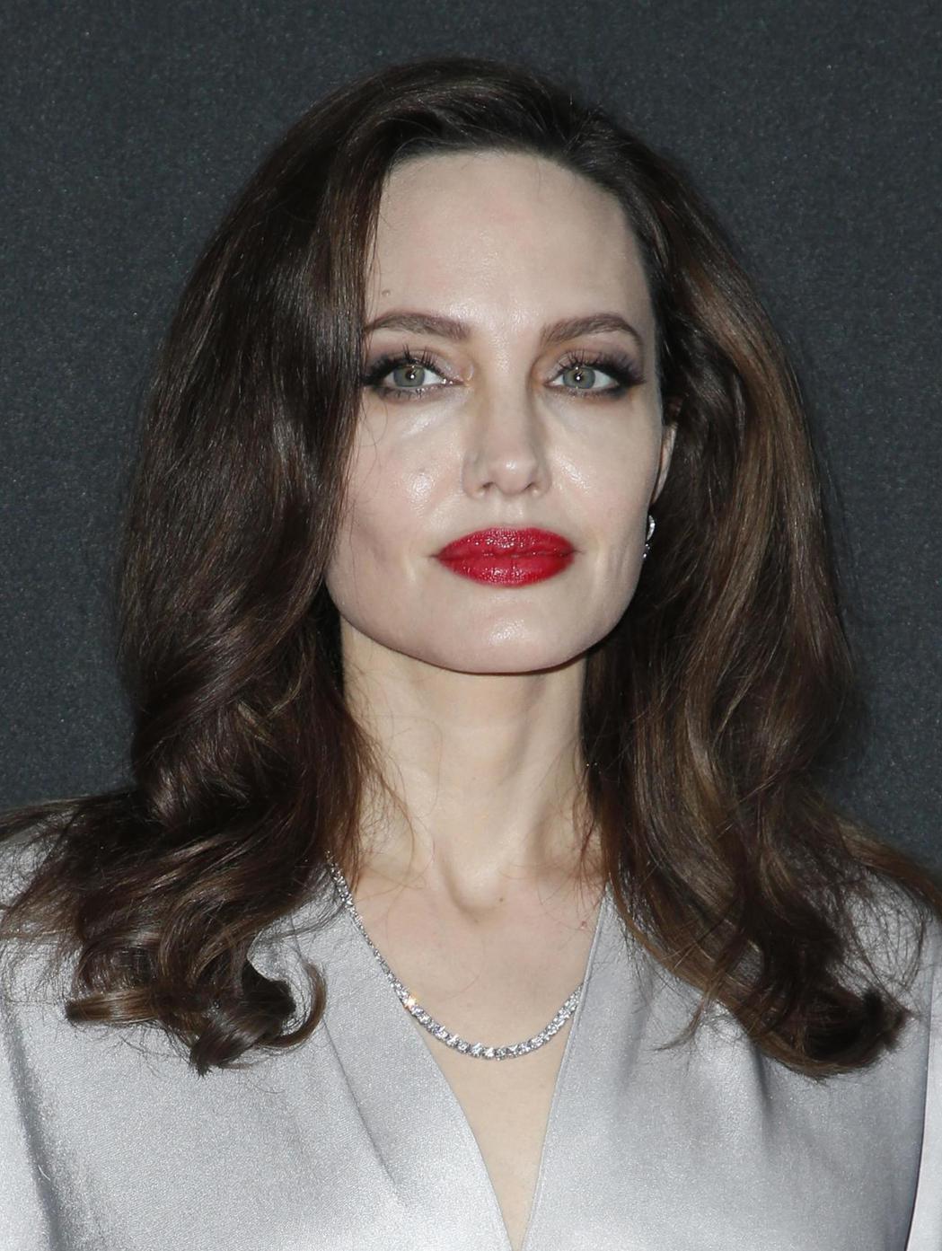 安琪莉娜裘莉的豐潤下唇也是目前受歡迎的唇形。圖/路透資料照片