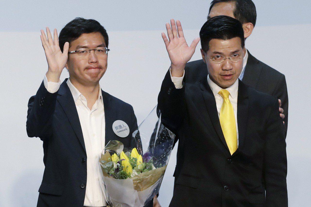 范國威(右)在這次補選以18萬3762票勝出。 美聯社