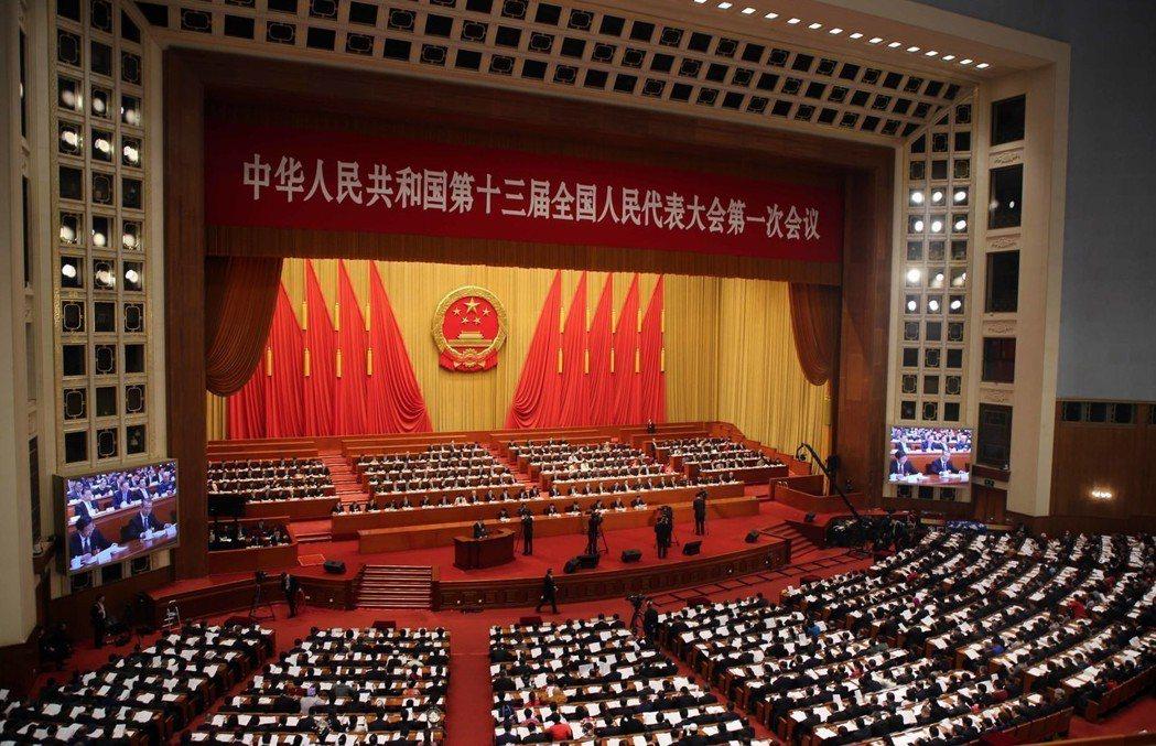 3月13日,十三屆全國人大一次會議在北京人民大會堂舉行第四次全體會議。圖為大會會...