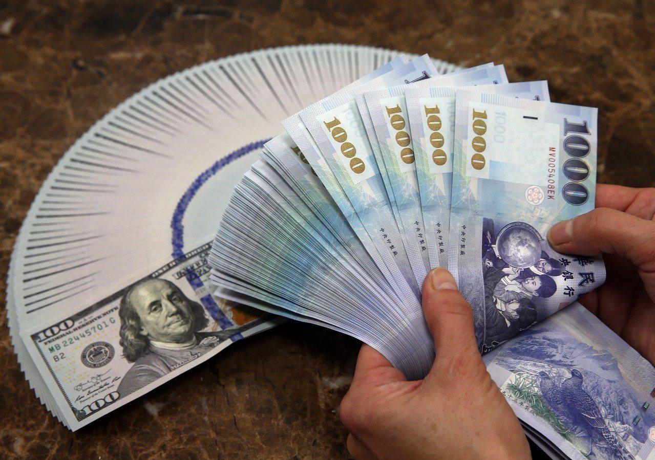 新台幣中午暫收29.169元,升3.1分。聯合報系資料照