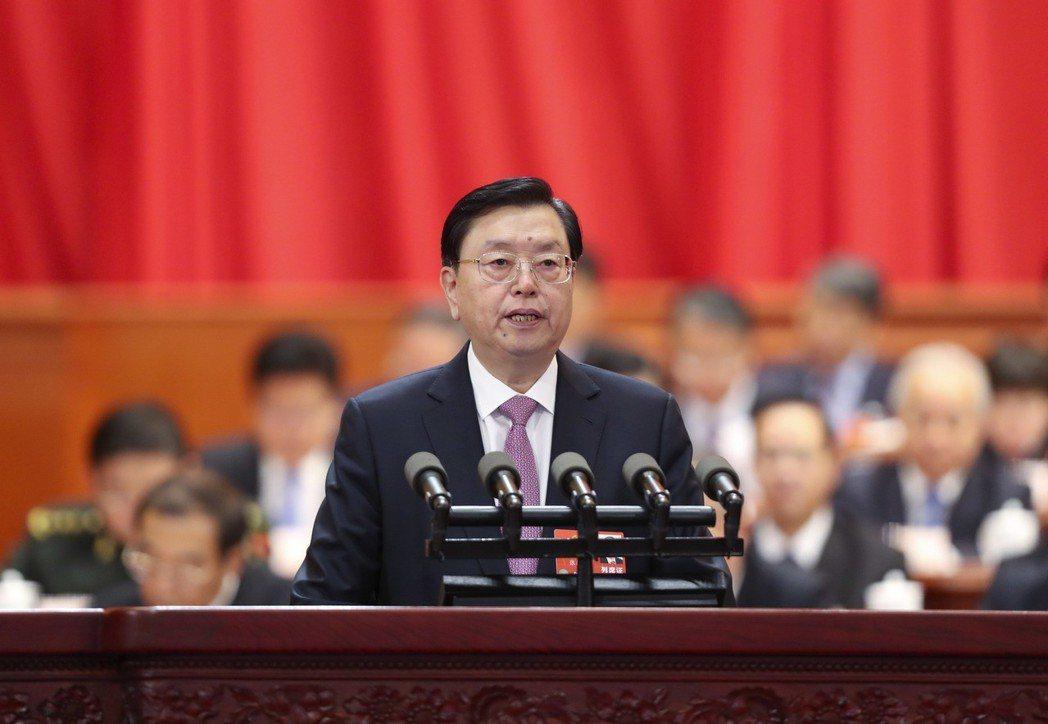 全國人大常委會委員長張德江,十一日在全國人大常委會進行工作報告。 (中新社)