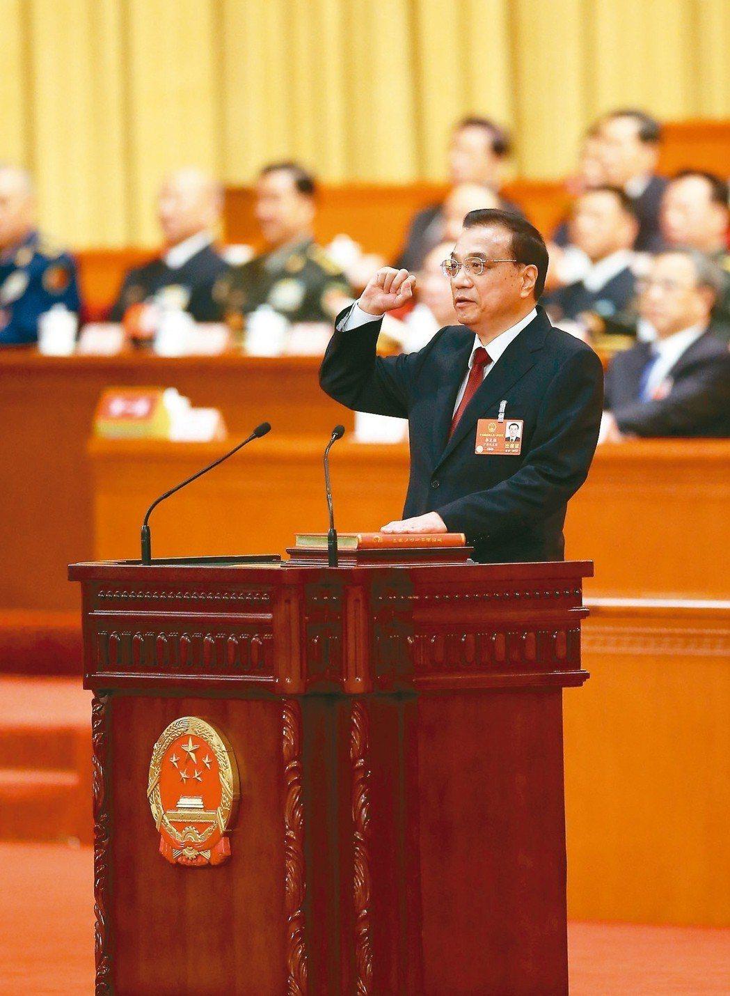 中共全國人大13屆一次大會昨天上午選出新一屆中共國務院總理,李克強高票當選,連任...