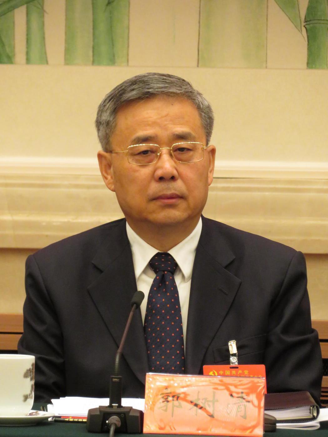中國銀保監首任主席郭樹清,圖為郭樹清去年出席中共19大中央金融系統代表團討論會。...