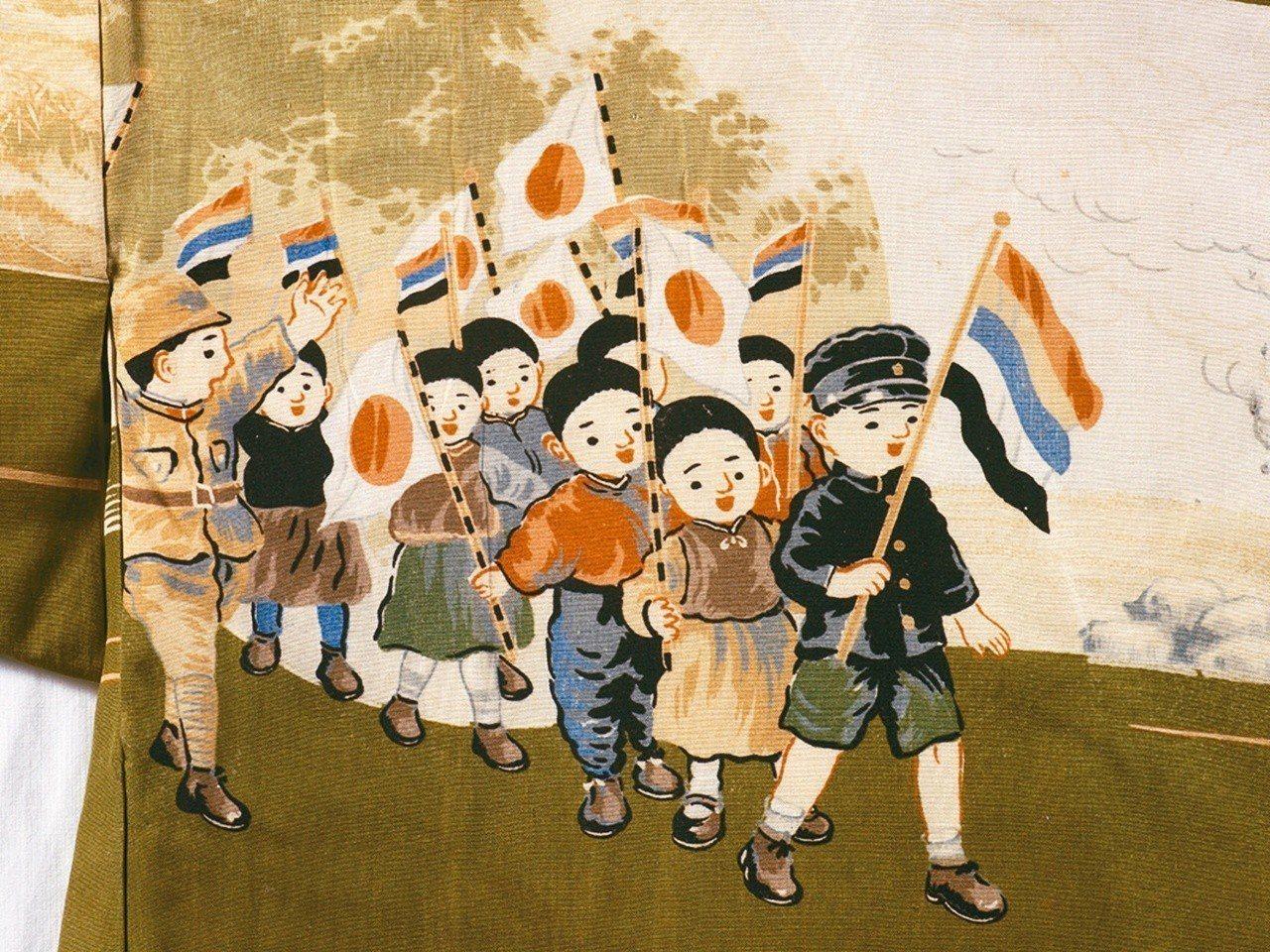 圖2:底端圖案是兒童拿著五色旗和日章旗遊行。