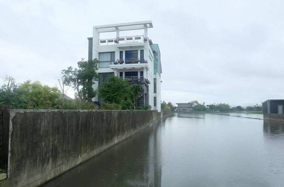 陳金德農舍原本擋土牆太高,違反「區域計畫法」。 圖/聯合報系資料照片
