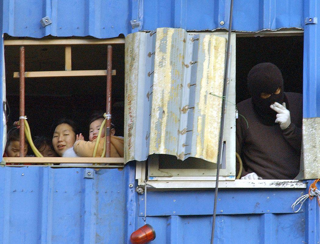 首爾的土地開發問題,在過去幾十年間屢屢造成嚴重的社會衝突與爭議。圖為2004年,...