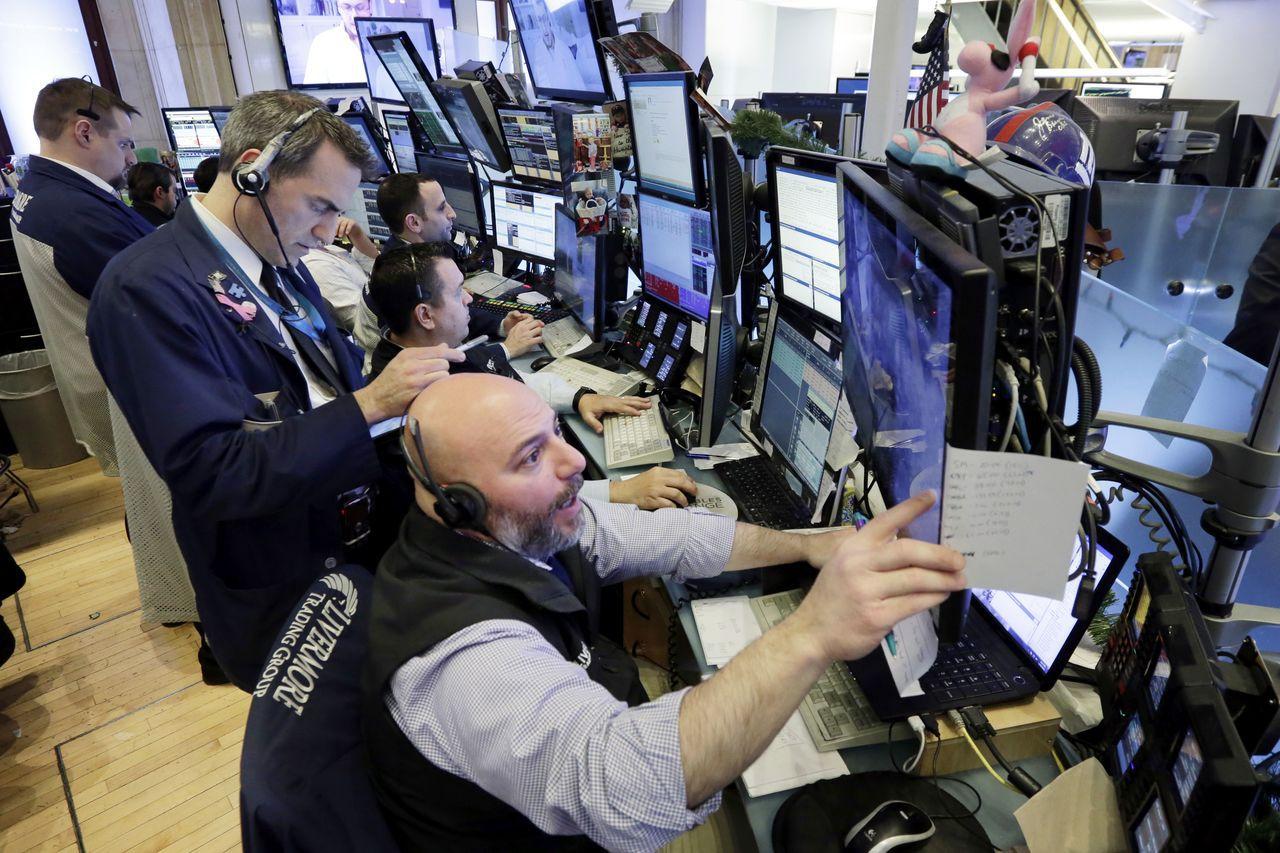 道瓊工業指數狂飆670點,是史上第三多漲點。美聯社