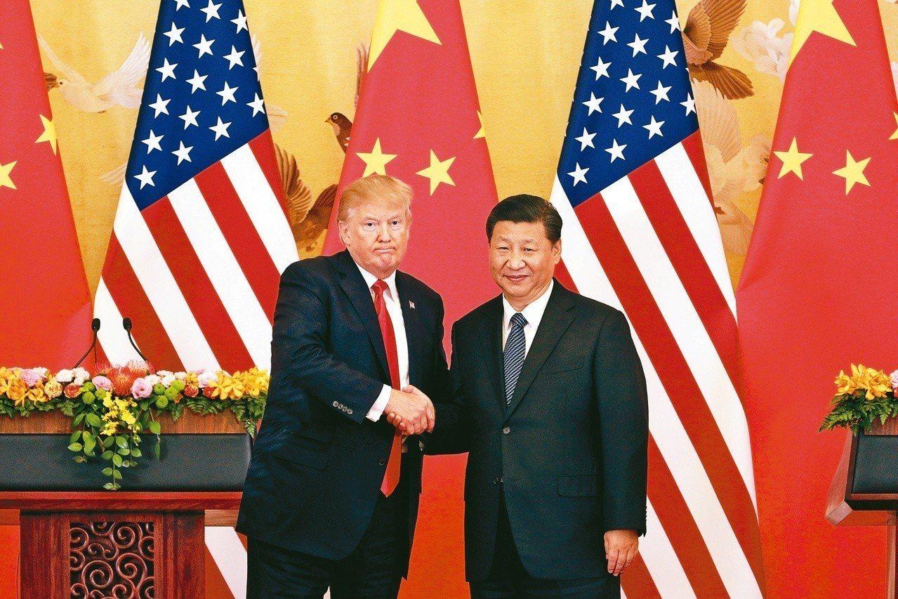 川普祭出貿易手段施壓中國大陸,掀起貿易戰。 美聯社