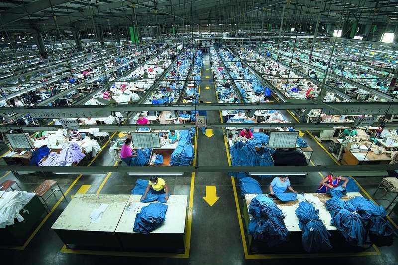 如興雖是全球最大牛仔褲製造廠,但併購手段和標的都讓人質疑。 總統府提供