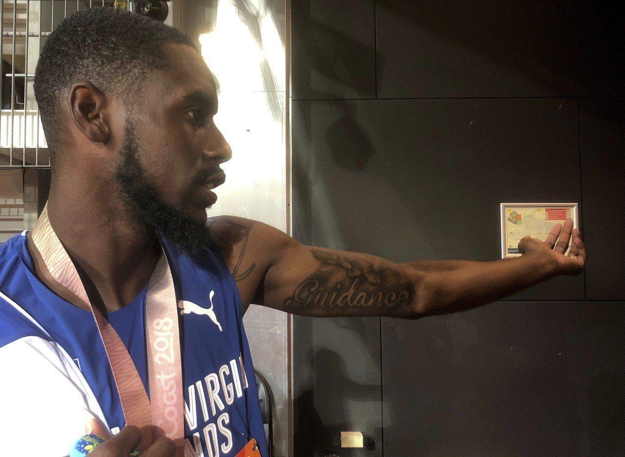 來自英屬維京群島馬克馬斯特12日奪下大英國協運動會400公尺跨欄金牌。美聯社