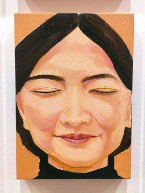 圖二:「閉上眼睛」,孤獨而安靜的人物頭像。
