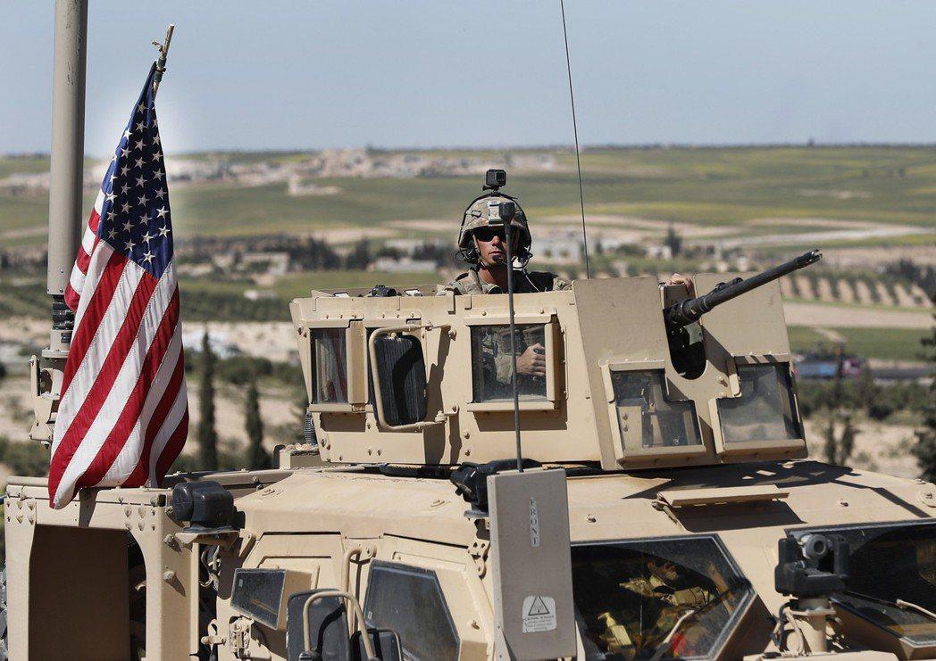 北韓對敘利亞遭盟軍空襲異常沉默。圖為在敘利亞北部的美軍。美聯社