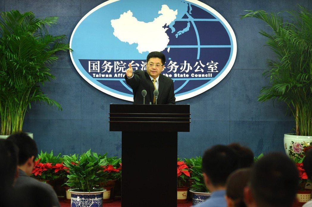 中共國台辦發言人馬曉光在新聞發佈會上回答記者提問。 中新社