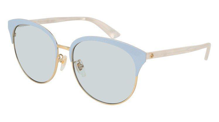 Gucci釉彩貓眼墨鏡,約12,555元。