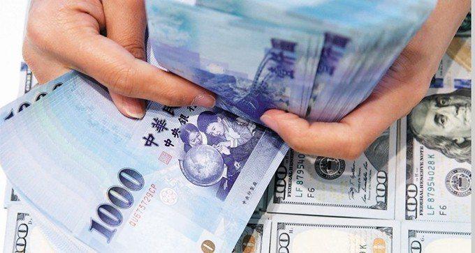 新台幣匯率。 報系資料照