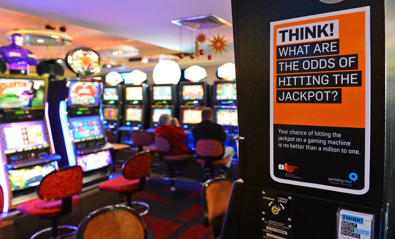 雪梨賭博電玩店的標語警告,中大獎機率渺茫。法新社