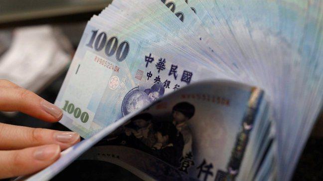 新台幣兌美元9日收盤收30.626元,貶1分。 圖/路透