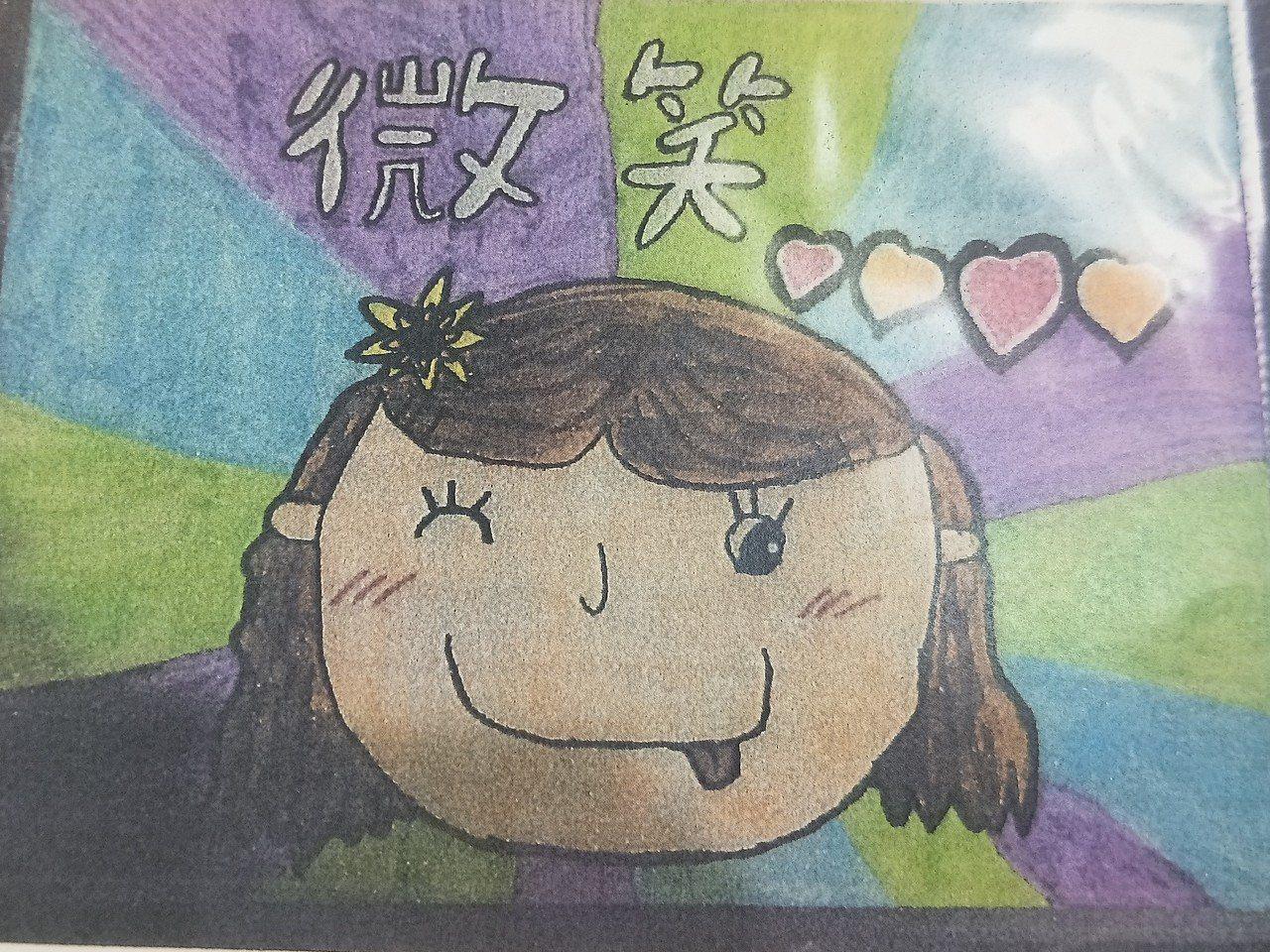 林依依以「微笑」為主題,在圖畫上畫出自己,還寫說要把歡樂當成禮物送給全世界,十分...