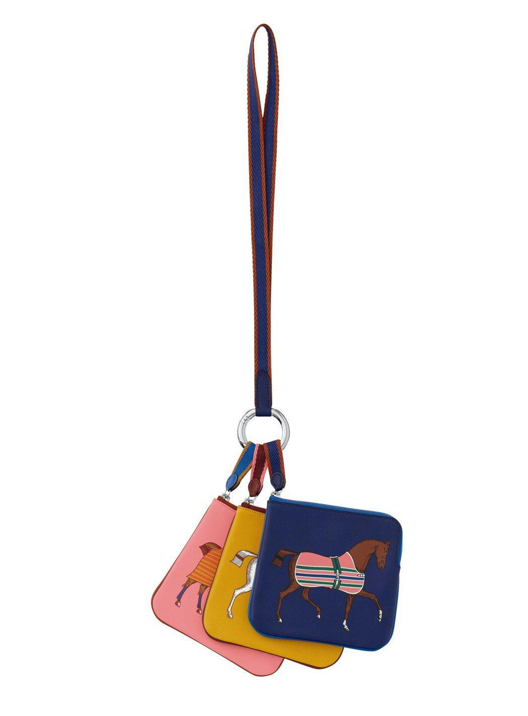 Carré Pocket 系列Swift 小牛皮零錢包,30,000元;搭配 G...