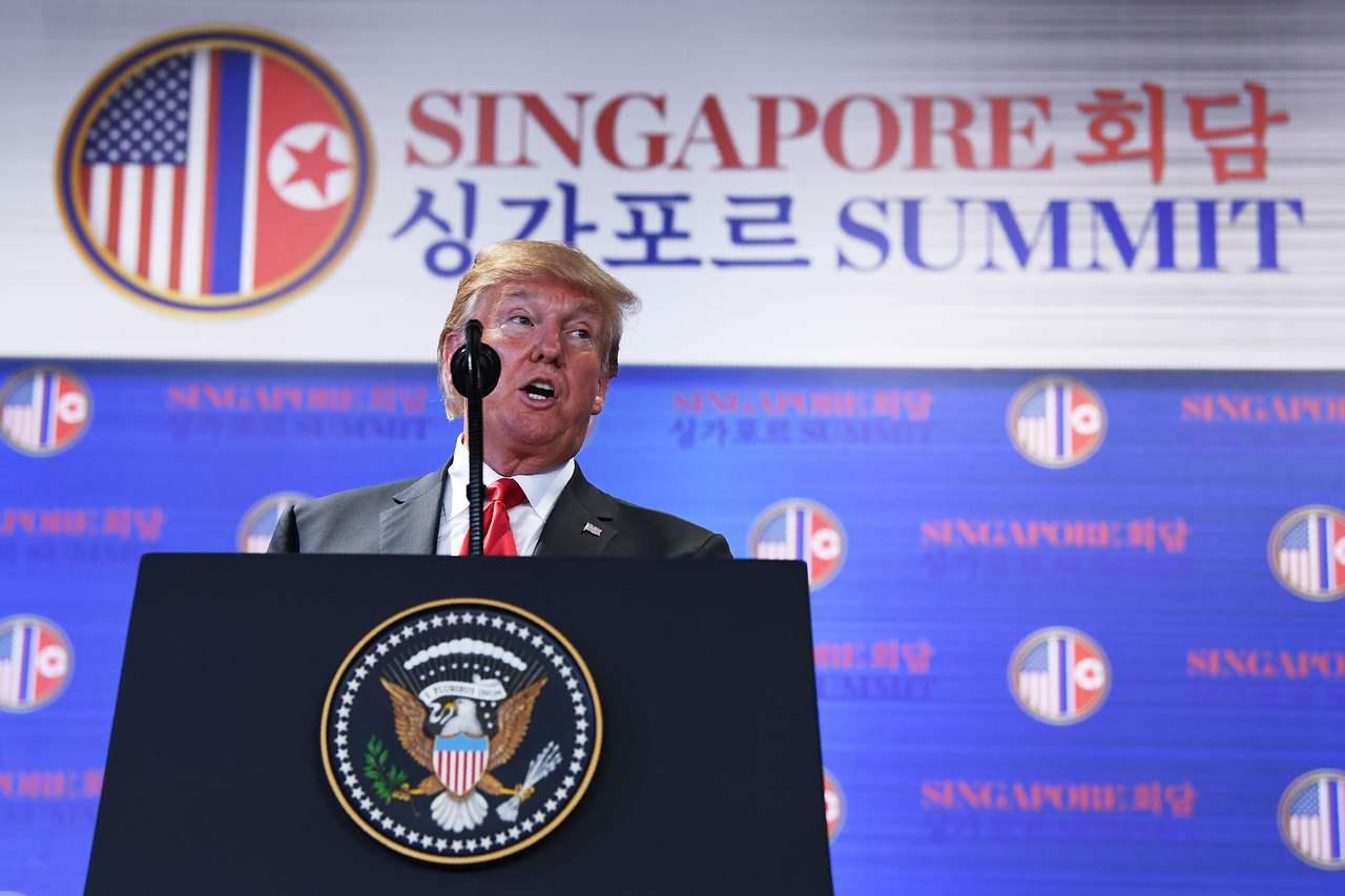美國總統川普12日16:00舉行記者會。圖/法新社