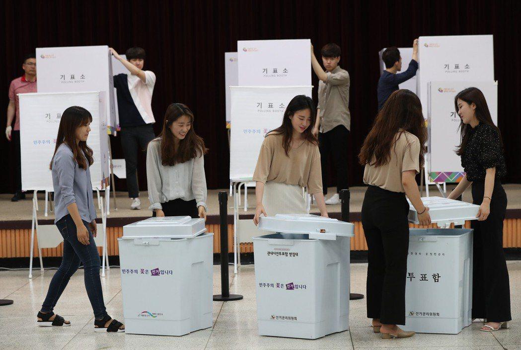 南韓地方選舉結果,開票到當地時間14日凌晨6點多,總算全部告終。 圖/歐新社