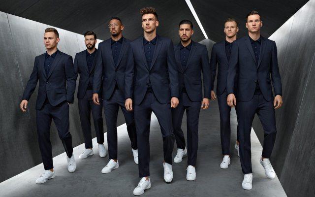 德国足球队以一袭蓝色西装配上白鞋,吸走粉丝目光。图/取自HUGO BOSS官网
